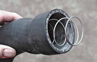 Regardless of what some hose manufacturers and technicians may tell you, always use an anti-collapse spring in the lower radiator hose. Hose collapse happens with the engine at high RPM and the water pump out-pumps the hose capacity.