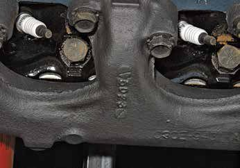 """Date codes are cast into the manifold. This date code is """"5D23,"""" indicating a casting date of April 23, 1965."""