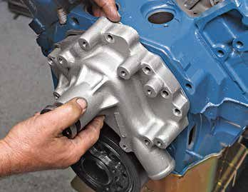 This is an aftermarket 351C/351M/400 water pump. It illustrates what happened in 1970 on all Ford small-block V-8s: Ford went to a true crossflow cooling system, which meant moving the water pump inlet to the driver's side of the engine. You must have a compatible timing cover to go with the 1970–up crossflow water pump on all 302/351W small-block Fords.