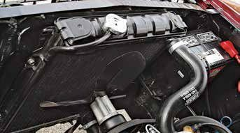 """Small-block Fords not fitted with air conditioning received this 17- to 18-inch four-blade """"X"""" fan along with the appropriate spacer and pulley. It did not employ a shroud and was positioned approximately 1 inch from the radiator."""