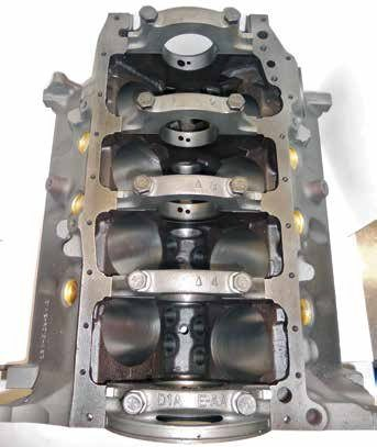 Underneath, the 400 block reveals its larger 3.000-inch main journals and D1AE-AA two-bolt main caps. This block can be converted to four-bolt main caps thanks to generous pan rails and main webs. T Meyer Precision Automotive Machining offers four-bolt main steel billet main bearing caps for the 351M and 400. (Photo Courtesy Tim Meyer)