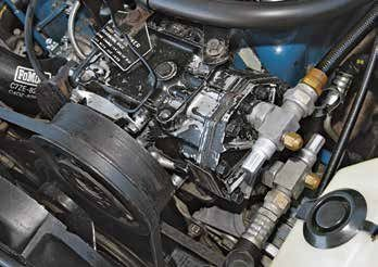 Small-block Ford V-8s were fitted with two types of air conditioning compressors early on. The York compressor (shown) is cast aluminum and lighter than the cast-iron Tecumseh compressor. They are interchangeable. This is a 1967 289 with the York compressor and belt tension adjustment down at the water pump.