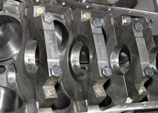 This is the E6ZM's bottom end with thick iron webbing and steel four-bolt main caps. This is basically a 351W block with 351C mains and the 351C's 9.200-inch deck height. You can build it for street, strip, or both.