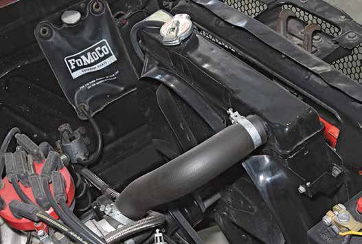This 19-inch radiator has been installed in a 1965 Mustang with the 289. It has proper fan shrouding and a five-blade fixed fan. However, due primarily to sizing, this Mustang suffers from overheating issues.