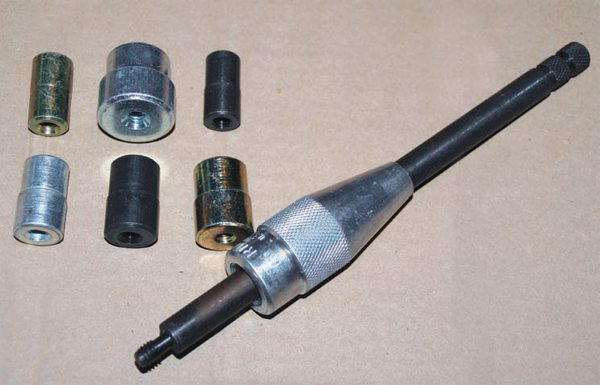 If you have no old transmission input shafts in your inventory, clutch alignment tools are commercially produced and available from auto parts stores. They run the gamut from a simple, inexpensive, one-size plastic tool by ACT to a professional-grade set by Lisle. This tool comes with various sized adapters to fit a multitude of clutch discs.