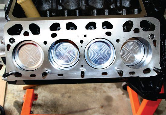 The now-assembled 322-ci performance short-block displays the custom dish-top RaceTec pistons, which, by providing a larger combustion volume, supply the desired compression ratio of 9.1:1. This is perfect for use with the factory McCulloch supercharger for this engine. In 1957 the factory horsepower rating for the supercharged 312 was 300. In reality, the engines produced between 340 and 370 hp. Without a dynamometer, I can't be exactly sure, but I am confident that with all the upgrades, my 322-ci engine will deliver in the neighborhood of 400 ponies on pump gas