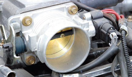 Modular engines are fitted with a variety of manifolds and throttle bodies. Most throttle bodies are like this one: a single bore that supplies eight cylinders. High-performance applications lean more toward a twin-bore throttle arrangement. Check your throttle body for cleanliness and proper function. Replace the throttle position sensor.