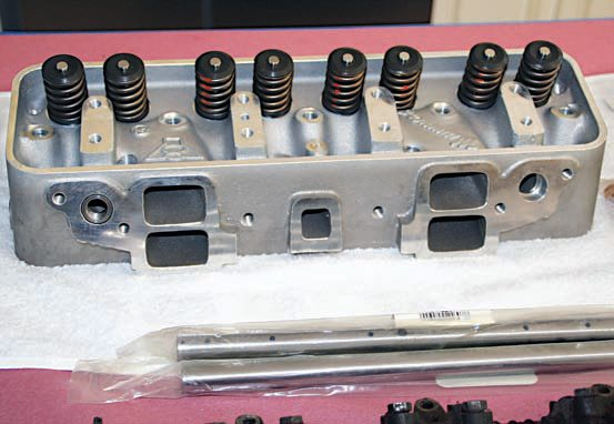 The redesigned aluminum cylinder heads by John Mummert have allowed the venerable Y-block engine series to make a serious leap into the 21st century when it comes to performance. The bare head castings weigh 24.5 pounds each, which is a considerable weight savings over the cast-iron OEM heads. Manganese bronze valveguides and Viton positive-seal valve seals keep oil out of the combustion chambers. As delivered, the Mummert head features a 1.250-inch-diameter valvespring with an installed height of 1.750 inches with 85 pounds of seat pressure on 1.375- inch spring cups. For more aggressive cam profiles that require larger valvesprings, the heads are machined to accept spring cups up to 1.460 inches in diameter.