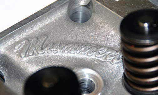 When he designed his cylinder head castings, John Mummert thought of everything a true Y-block enthusiast would love, including his logo, the Y-block logo, and the ECG casting letters. One of the biggest aids to performance, as well as weight savings, came in the form of the cylinder heads that I chose for this 322 Y-block buildup. They are John Mummert cast-aluminum cylinder heads. Modern CNC technology allowed Mummert to redesign the cylinder head ports for maximum efficiency and flow. Fitted with stainless-steel 11/32-inch-stem diameter 1.94- inch intake valves and 1.54-inch exhaust valves, these heads flow 235 cfm at a .550 lift on the intake and 175 cfm at a .550 lift on the exhaust side. The deck thickness is .625, combustion chambers are 60 cc, valve angle is 18 degrees, and the use of 14-mm spark plug holes improves combustion by eliminating valve shrouding that improves flame travel.