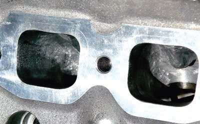 Of course, serious racers, including Jerry Christenson, try to wring every last ounce of power from any cylinder head, even those from Mummert. Evidence of Jerry's port and combustion chamber work are seen here. These modifications include increasing port size and removing material in the combustion chamber to decrease valve shrouding. These changes accommodate Jerry's engine combination and are not necessary for my street performance application.