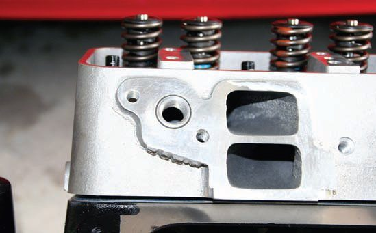 The Mummert cylinder heads are installed on the engine, and the intake ports are shown here. I have long wondered why Ford engineers chose this unusual horizontal intakeport configuration for the Y-block cylinder head. The answer is simple: Additional hood clearance, less material required in the head casting, and, my favorite, the orientation of the port does not matter to the engine. All that matters is how directly and efficiently the port transfers the air/fuel mixture to the valve.