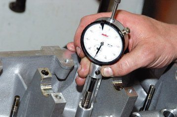 This dial indicator is used for measuring valvestem length. When you grind valve heads and seats, you change the valve's relationship with the cylinder head. This means you have to grind the valvestem tip to the proper length.