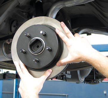 "A key step when converting from drums to discs is to ensure the new rotors are properly centered on the axle. You cannot depend on the wheel studs for this, and you must use the correct centering ring. This ring sits between the rotor and the axle flange while also just fitting over the hub in the middle of the axle. The outside diameter just fits inside the center bore of the new rotor. This results in a ""hub-centric"" positioning of the rotor, which does a much better job of minimizing differences between the rotor and axle centers (rotor runout)."