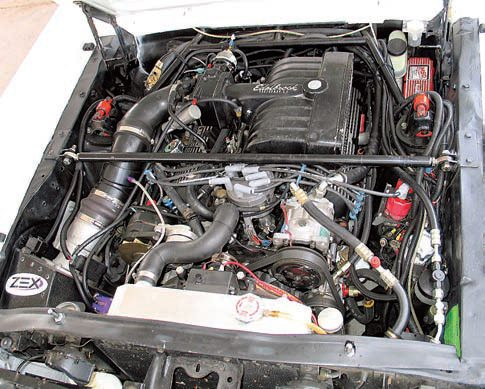 Early Mustangs benefit greatly from a Monte Carlo bar (the straight, adjustable bar between the shock towers) and an export brace (the fixed bars running between the firewall and the shock towers). These can be adapted to work with most engine swaps such as this 5.0L EFI engine. They should both be used whenever possible.