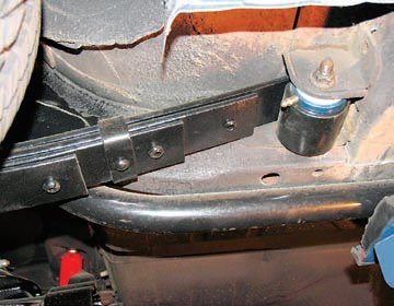 The rear spring eye receives the same type of Del-A-Lum bushing and enjoys the same benefits. In addition, the frame bushing is also replaced with a Del-A-Lum bushing to eliminate another source of unwanted compliance and instability. This firming up of the leaf spring mounts requires stronger shackles to ensure the springs stay properly located.