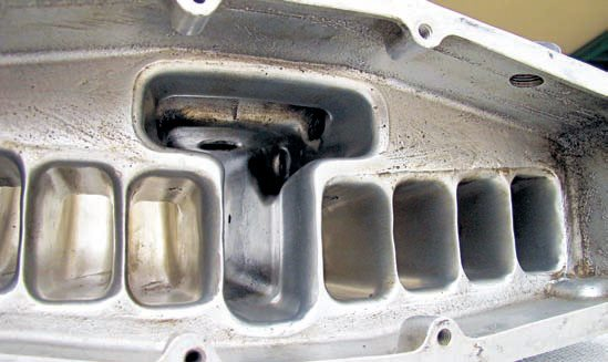 If you extrude hone the intake manifold, this process removes the rough casting from the interior surfaces and balance flow for the best possible cylinder-to-cylinder air/ fuel distribution. It removes and/or smoothes any surface imperfections leaving a very smooth and uniform surface finish. This greatly enhances flow, and each runner can then be treated individually to achieve virtually identical flow through all runners.