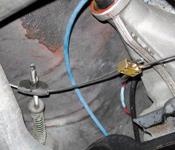 To make universal cables work it's sometimes necessary to splice them to each other or to the original factory forward cable. Here, the very long factory cable was replaced by two shorter cables that have been spliced together. This approach allows you to route the cables through the factory guides.