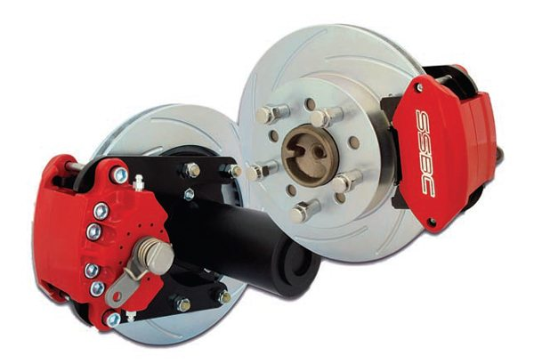 When upgrading your rear braking it often involves at least a larger vented rotor that's also slotted. The caliper design is more robust and uses a larger piston or more pistons and aggressive compound brake pads. A high-quality kit with matched components fits the bill. Kits include all the necessary mounting hardware (note this kit also includes a split mounting flange so it's not necessary to remove the axles) plus other items such as braided lines and a manual proportioning valve. (Photo Courtesy Stainless Steel Brakes Corporation)