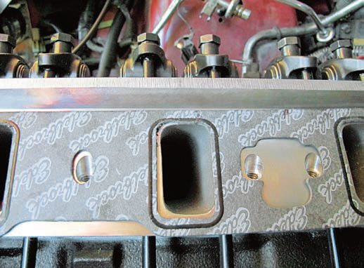 Always use a premium gasket, such as this Edelbrock intake example. It isn't the leastexpensive option, but it's made from high-quality materials and has desirable features such as the imprinted bead around the port opening. You need to make sure they don't block the ports. Sometimes it's just a matter of repositioning them. Sometimes you may have to trim them to match the ports.