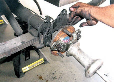 The majority of rear disc brake kits require removal of the rear axles to install the caliper mounting plates. A few (such as the SSBC kit) do not require this. Other than as a matter of convenience there's little difference in the performance of either type. In general, kits designed for extreme braking are inevitably single-piece designs to obtain the greatest strength with minimal weight. If you remove the axles it's always best to inspect and/or replace the axle seals and bearings.