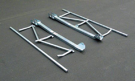 These Global West tubular upper control arms are stout enough to handle even the most extreme loads. They can come with revised geometry to further improve handling in street or road race use. They allow use of all stock components but, realistically, these parts should also be upgraded to achieve the best result. Note the use of Del-A-Lum bushings (no rubber), the reinforced spring perch mounts, and the extra bar.