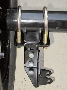 The mounting brackets for the lower links are simple to bolt on because they are located by the spring pad pegs on the axle. Ensure the nuts on the U-bolts are evenly tightened and not overtightened to the point of warping the flanges. Some of the provided locknuts are fairly thin so it's easy to strip them; thicker ones are easy to find.
