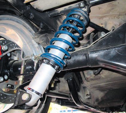 The finished installation shows these coil-overs, which allow the usual adjustment to ride height and valving (via the adjustment knobs at the top of each coil-over). Non-adjustable and doubleadjustable versions plus other springs are available. The lower links can be mounted in any of three locations to optimize the geometry for different purposes.