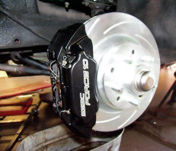 An aftermarket four-piston caliper is a much better choice than the original/ OEM versions. This SSBC product also has a quick-change pad feature, which utilizes simple clips instead of bolts, thus eliminating the need for a tool. It is also much easier to fi nd pads in a variety of compounds compared to older/OEM parts. A system such as this is clearly a superior choice for regular street use as well as being able to handle frequent, yet moderate, track use.
