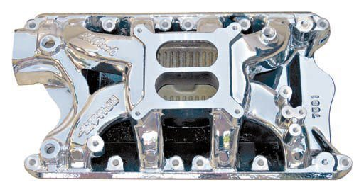 """This Edelbrock RPM Air Gap dual-plane manifold is optimized for an RPM range of 1,500 to 6,500. The runners have been raised above the floor of the manifold (the """"air gap"""") to remain cooler and transfer less heat to the mixture. The exhaust passage for the choke has been eliminated so a manual or electric choke must be used. The intake runner cross-sectional area and the height of the carb-mounting flange have been increased to produce more top-end power with minimal loss at lower RPM. This type of manifold is exceptionally good for a moderately to heavily modified street-driven high-performance car. (Photo Courtesy Edelbrock)"""