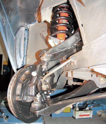 This front suspension uses reinforced stock-type control arms and strut rods and upgraded bushings. The springs and shocks have been replaced with more performance-oriented parts plus the spring perches were replaced with polyurethane parts. Even though much more radical (and costly) options are available, this simple level of upgrading still makes a dramatic improvement in vehicle performance.