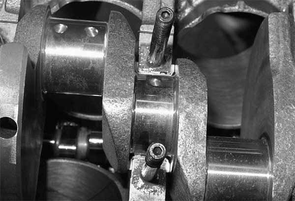 The Scat 331 stroker crank is carefully installed. End play must be checked with a dial indicator at the front of the crankshaft. When we check end play, we are checking side clearances at the thrust bearing shown here. End play should be .0004 to .0008-inch.