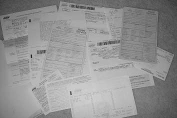 """Here's a pile of paperwork and letters I have left over from the seven-month process I had to endure when I tried to register a car without a """"clear"""" title."""