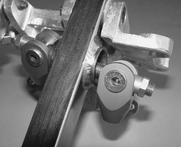 This is a balance bar for the Tilton brakepedal assembly. A spherical bearing is located in the pedal. The threaded rod moves the bearing from side to side for the correct amount of front and rear master-cylinder actuation. Front and rear brake bias can be adjusted from the driver's seat with a remote-mounted knob.