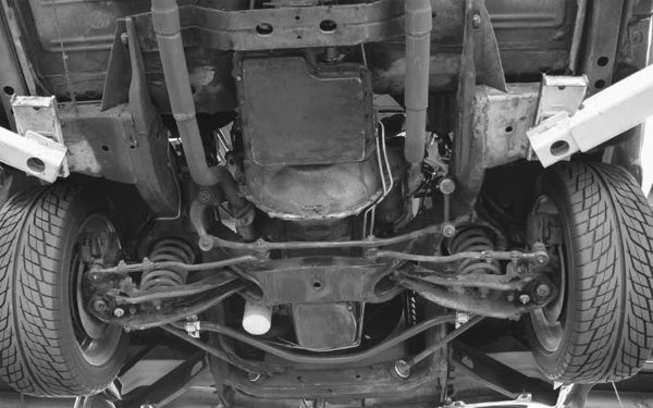 A closer look shows the torque boxes that attach the outside frame rails in the center of the car, to the narrower front portion of the frame. These frames are heavy but strong, and they can be gusseted for extra strength