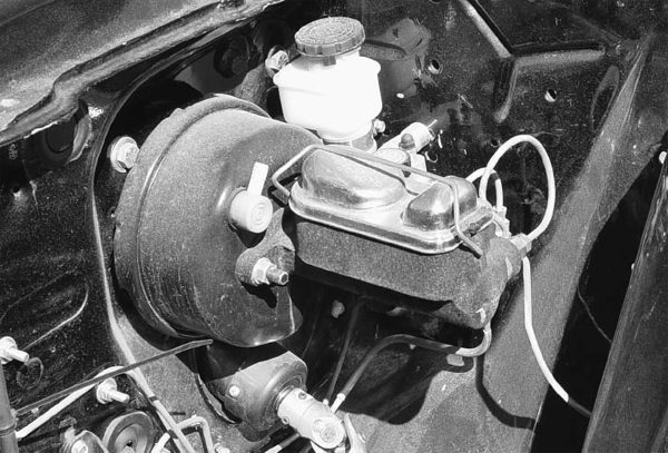 High-performance engines don't always produce enough vacuum to actuate the diaphragm in the brake booster for good braking power. You can install a canister that stores vacuum for braking when you need it. Switching to manual brakes require more pedal effort and more room in the engine compartment.