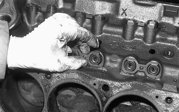 Remove lifters. If you're dealing with a roller block, remove the spider, then the dog bones and lifters. Since you are building extra power with a stroker, we suggest replacing the lifters. Specify a complete new roller camshaft kit, which will include roller tappets, dog bones, and spider. Don't throw the spider and dog bones away, however.