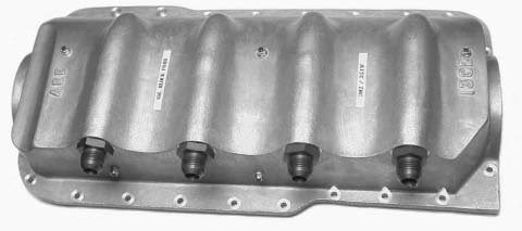 This cast-aluminum drysump oil pan is manufactured by Armstrong Race Engineering (ARE). ARE sells cast valve covers, oil pans, and dry-sump pump kits for multiple Ford engines. These pans are very beefy parts so they offer extra rigidity to the engine block. (Photo courtesy Armstrong Race Engineering)