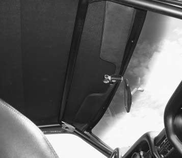 When building your roll cage, take safety and function into consideration. David McMillan's '69 Mustang roll cage has a cross-bar positioned far enough forward to clear his noggin, but far enough back so he could use his sun visors.