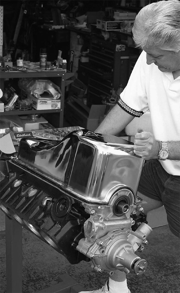 Mark installs the new oil pan from Trans Am Racing. Although this is a chrome oil pan, per the customer's request, Mark discourages the use of chrome oil pans. They retain heat. They also rust because the plating quality is generally poor.