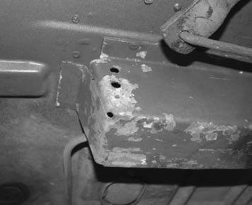 Here is a good view of a front sheetmetal frame rail. The rail is simply a folded-up piece of metal that's tack welded to the sheetmetal floorboard. It's strong enough for regular driving, but it could use some strengthening for the type of driving Restomods sometimes see.