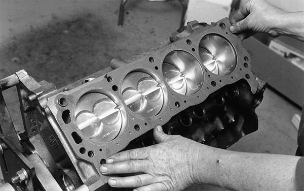 """Overheating problems plague smallblock Fords because builders install the head gaskets backwards. """"FRONT"""" means FRONT on both sides. Coolant passages in the head gaskets must be positioned at the rear of the block as shown. This enables coolant to circulate through the entire block and heads."""