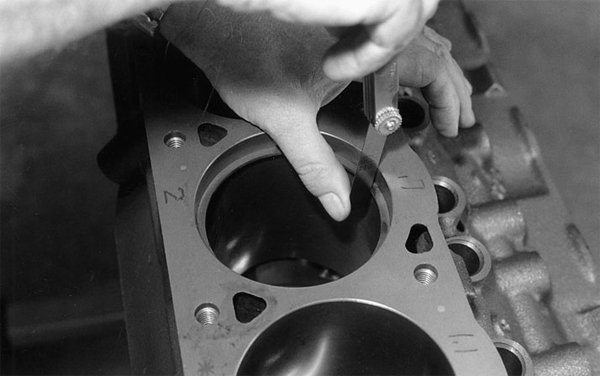 Above and below: All piston ring end gaps should be checked. Never kid yourself. No two sets of rings and cylinder bores are the same dimension.