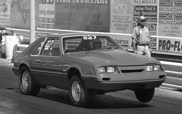 Drag racers need less rubber in front and more rubber in back. We also want a suspension profile that distributes the weight to the rear wheels when the throttle is pressed and the clutch released.
