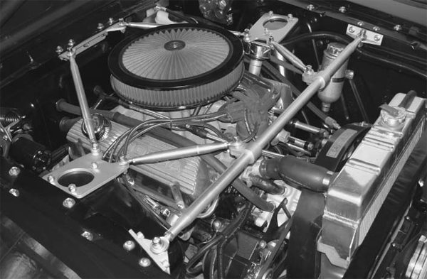 The healthy 351W was already in place. Tate added A TCP Tower Brace kit to strengthen the front unibody structure. The modified Shelby hood scoop feeds directly into the top of the K&N air filter.
