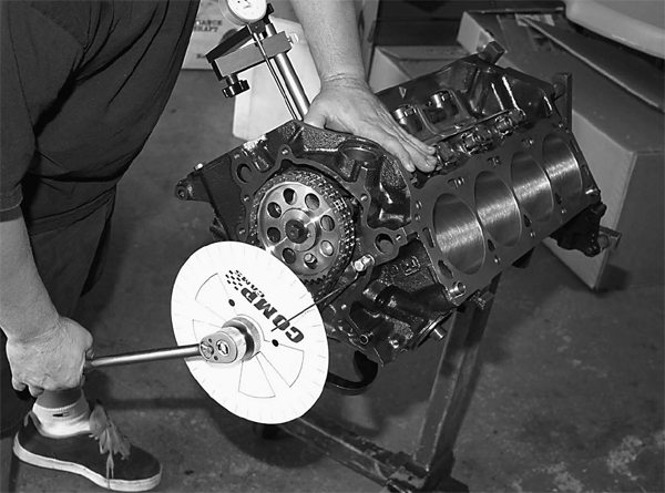 John Da Luz of JMC Motorsports degrees the camshaft and checks crankshaft indexing at the same time. This determines proper camshaft specifications and piston deck height.
