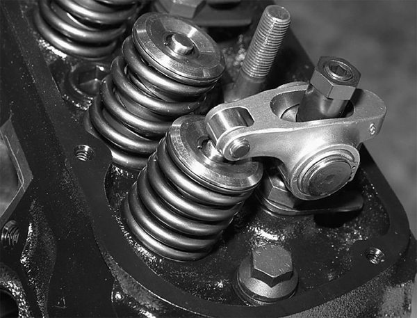 With the cylinder head, pushrod, and rocker arm installed, we hand crank the engine through two complete revolutions.