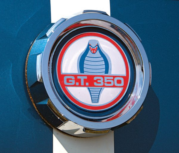 To further differentiate the 1966 GT350 from the 1966 Ford Mustang, a new decorative gas cap was incorporated. It combined the Peter Brock–designed stylized cobra snake, which he originally developed for the Shelby 289 Cobra, and GT350 lettering in place of the word COBRA. These were manufactured by Stant and were used from the beginning of 1966 production. The occasional use of a Mustang gas cap may have resulted from a lack of GT350 caps and the desire to not hold up production while arrival of the correct parts was pending.