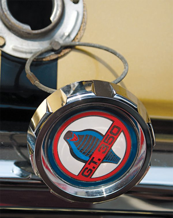 Shortly after its introduction in 1964, Ford (and Mustang owners) learned quickly that the chrome and plastic fuel cap made an excellent souvenir, and some may have been left atop the gas pump. The solution was a circular steel cable that wired the cap to the car, making theft almost impossible. This procedure was also carried forward to the 1966 GT350 gas caps.