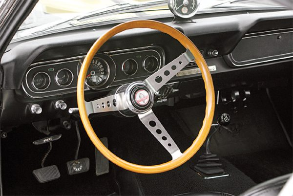 A popular and persistent misconception is that there was a real wood steering wheel available as an option on the 1966 GT350; such was not the case. Several styles of wood wheels were available as over-the-counter (OTC) accessories from the Shelby American accessories catalog. A couple of subtly different variations existed with the slight differences being seen in the area of the spokes where they met the wood rim.