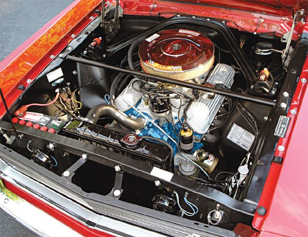 In general terms, the goings-on under the hood of a 1966 GT350 are very similar to those of a 1965 car with the aluminum engine parts, steel tube headers, and frame stiffening members (export brace, special shock absorber beehives, dash panel reinforcement, and Monte Carlo Bar) carried over into the new model year. All of those parts are in fact interchangeable between the two years.